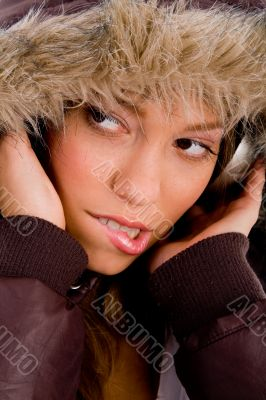 adult woman with woolen coat listening music
