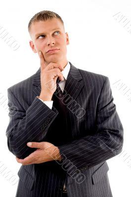 thinking young businessman looking upward