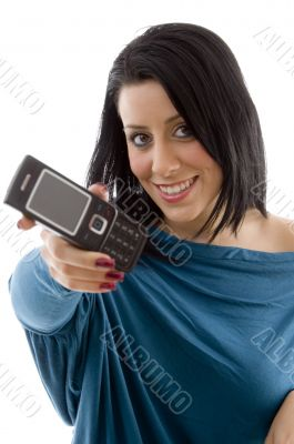 smiling female showing mobile on white background