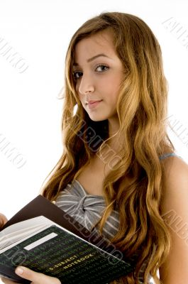 beautiful teenager student with notebook