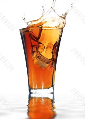 soft drink with a splash isolated on white