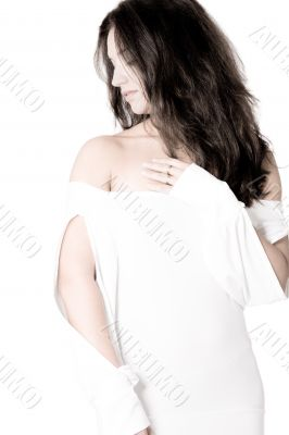 brunette in white shirt on white background high key looking asi