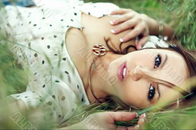 girl lying down of grass