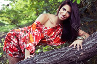 beautiful girl on grass in beautiful and colourful dress