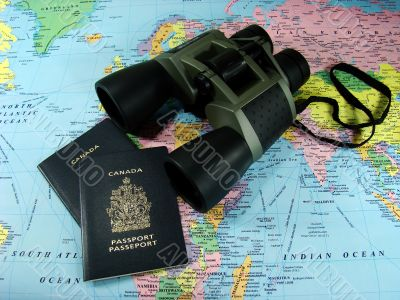 Binoculars, map and travel passports
