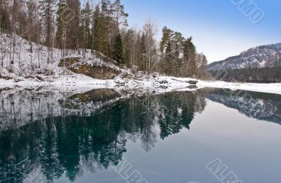 Blue warm nonfreezing lake in Mountain Altai.