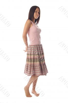 Young woman in skirt and tank top