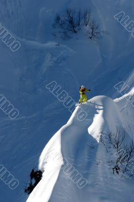snowboarder ride on high mountain