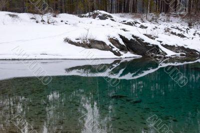 Rocky coast of nonfreezing blue lake