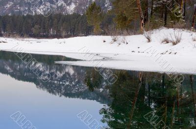 Nonfreezing Blue lake in Mountain Altai. Siberia.