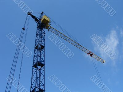 Lifting construction crane at blue sky
