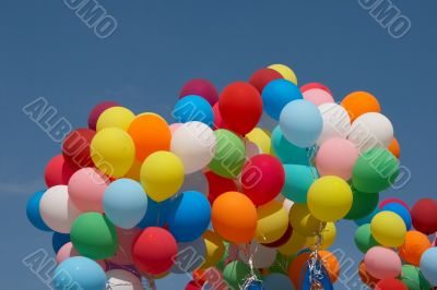 Countless colorful balloons in deep blue sky