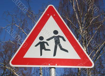Warning sign near a children`s playground