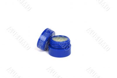 Lip balm in blue container