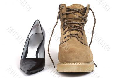 Black Women`s High-Heel Shoe beside men`s workboot