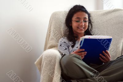 cute child reading notebook