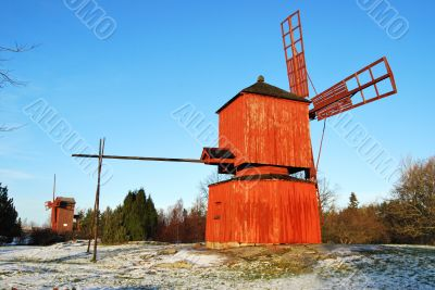 Two Red Wooden Windmills
