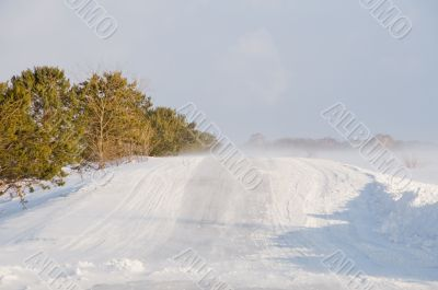 A bad weather on rural road.  Glaze ice,