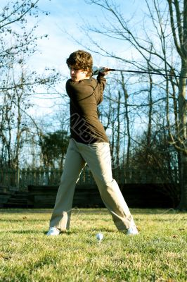 Youth golfer in swing