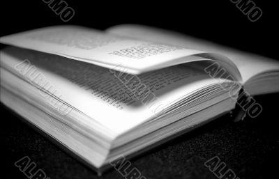 Open book on black monochrome