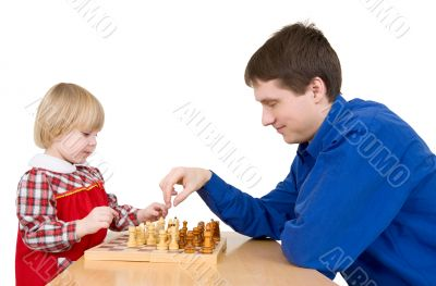 Man and girl play chess