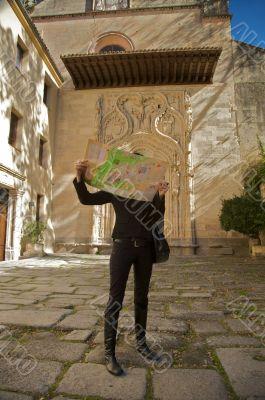 tourist reading map of segovia