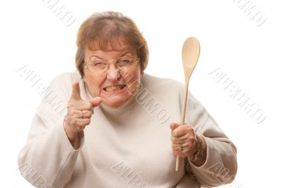 Upset Senior Woman with The Wooden Spoon