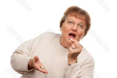 Attractive Senior Woman Taking Pills
