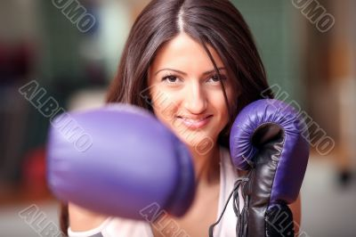 The beautiful girl in boxing gloves
