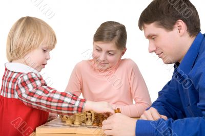 Man and children play chess