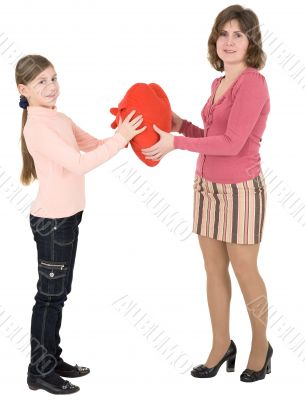 Woman give heart to girl