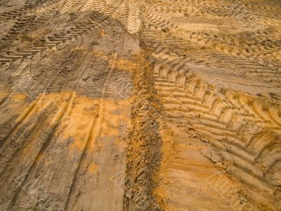 Car traces in sand