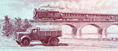 Truck and steam passenger train crossing viaduct