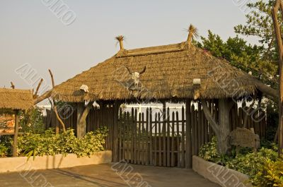 Gated entrance with thatch roof