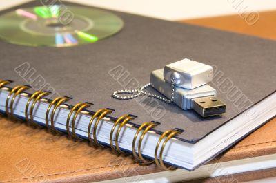 flash-drive & cd & 2 notebooks