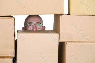 Man looking through pile of cardboard boxes