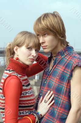 Young couple - the guy and the girl outdoor