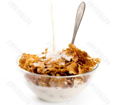 milk pouring onto cornflakes