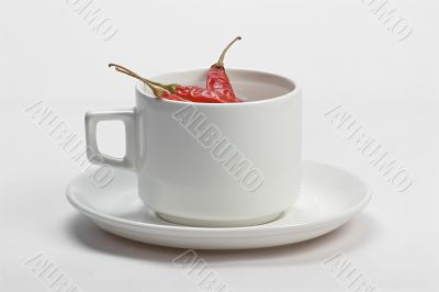 Red chilly in white cup
