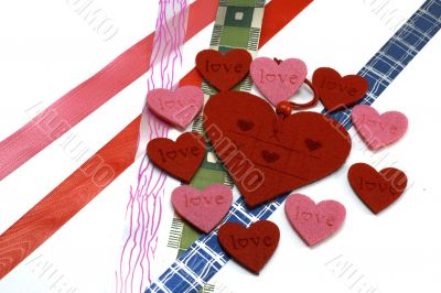 A lot of red and pink hearts with colours bows