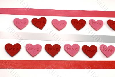 A lot of red and pink hearts with colours ribbons