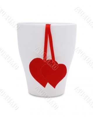 A cup with two red hearts