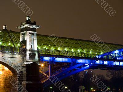 Highlighted bridge construction at night.