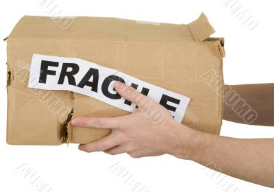 Crumpled cardboard box with inscription `fragile`