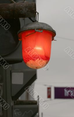 A red street lamp
