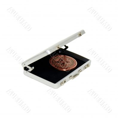 Intricate coin in silver briefcase