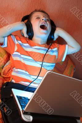 Young screaming kid with headphones