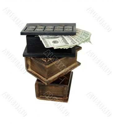Stack of money in wooden books