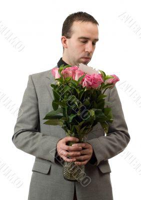 Man Smelling Roses