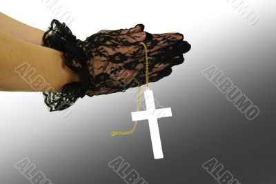 Praying hand with gold cross